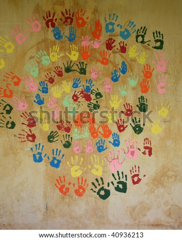 Prints of hands on the old wall - stock photo