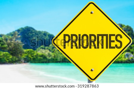 Priorities sign with beach background - stock photo