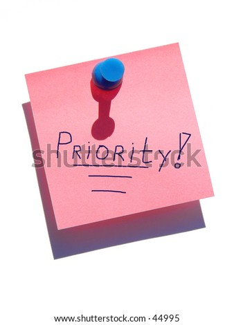 Priority note on white background - stock photo