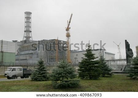 PRIPYAT, UKRAINE - NOV 30: General view of sarcophagus over 4-th block Chornobyl nuclear power station on November 30, 2006 in Chornobyl Exclusion Zone, Pripyat, Ukraine. - stock photo