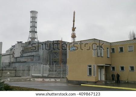 PRIPYAT, UKRAINE - NOV 30: General view of sarcophagus over 4-th block Chornobyl nuclear power station on November 30, 2006 in Chornobyl Exclusion Zone, Pripyat, Ukraine. - stock photo