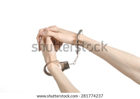 Prison and convicted topic: man hands with handcuffs isolated on white background in studio, put handcuffs on killer - stock photo