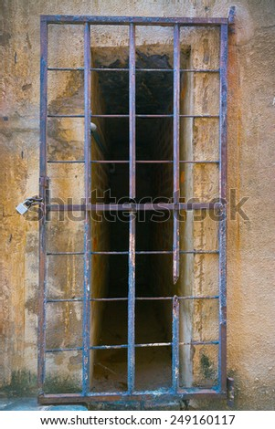 Prison window with steel grating - stock photo