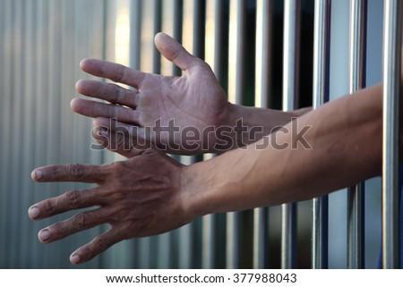 prisoner in jail - stock photo