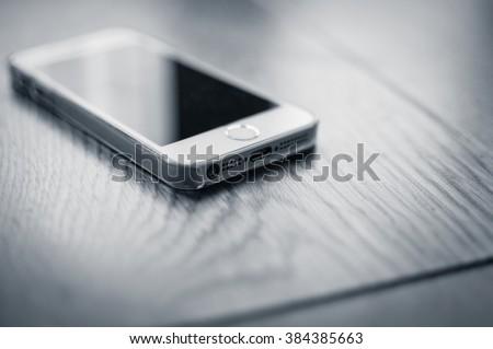 Pristine new business smart phone - stock photo