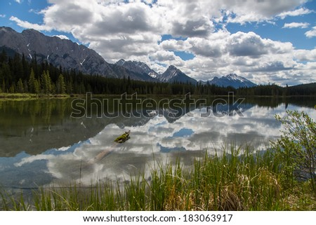 Pristine transparent lake in Canadian Rockies - stock photo