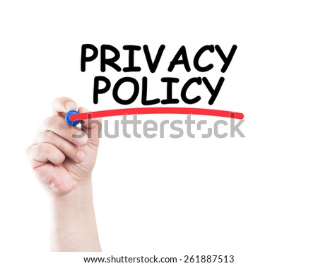 Privacy policy concept made by a human hand holding a marker on transparent wipe board - stock photo