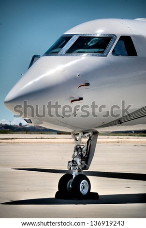 Private Airplane in vertical shoot blue sky in airport - stock photo