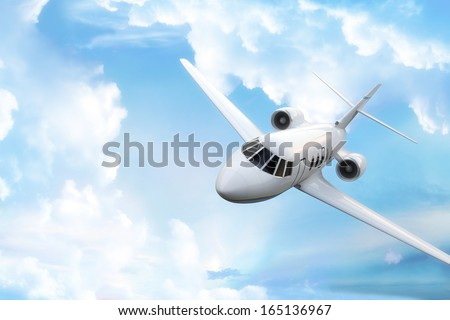 Private business jet with sky background and room for text or copy space - stock photo