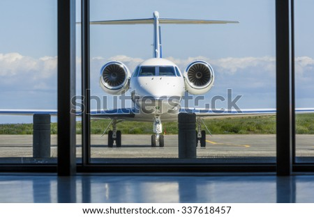 Private corporate jet airplane or aeroplane parked at an airport - stock photo