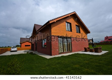 Private house in Europe with red bricks and tilled roof - stock photo