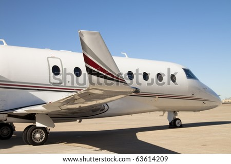 Private Jet Airplane A side view of a private jet airplane. Horizontal. - stock photo
