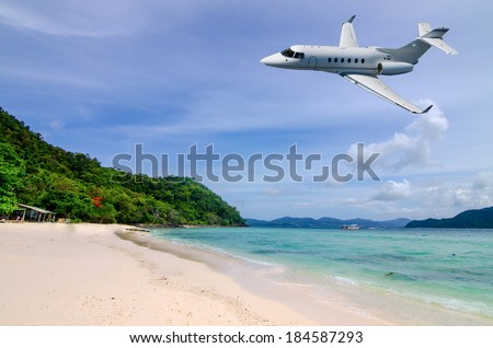 Private jet is arriving tropical resort in the morning - stock photo