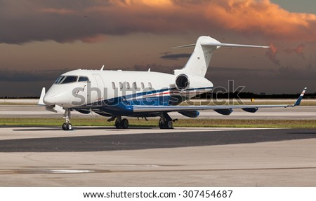 Private jet on the runway - stock photo