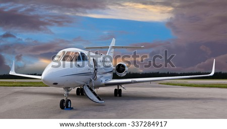 Private jet on the runway with the stair down - stock photo