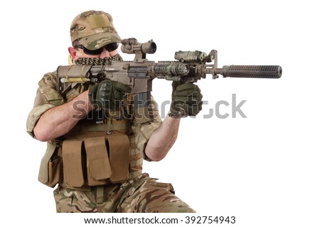 Private Military Company operator with assault rifle on white background - stock photo