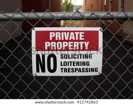 Private Property Sign on a Chain Link Fence  - stock photo