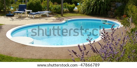 private swimming pool in garden - stock photo