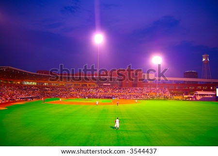 Pro baseball stadium at dusk - stock photo