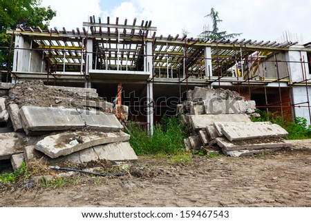 Probably because of financial problems the construction site stopped until further notice. - stock photo