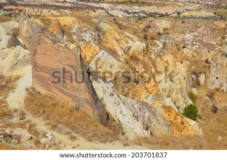 Probably the best known feature of Cappadocia, Turkey found in its very heart, are the fairy chimneys of Goreme and its surrounding villages - stock photo
