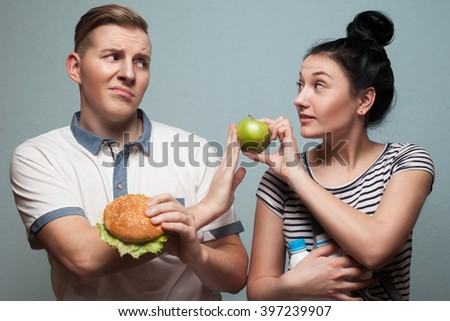 problem of choice of good food or no good food - stock photo
