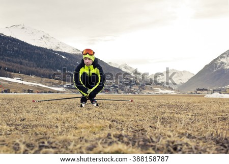 problem of globar warming and winter skiing - stock photo