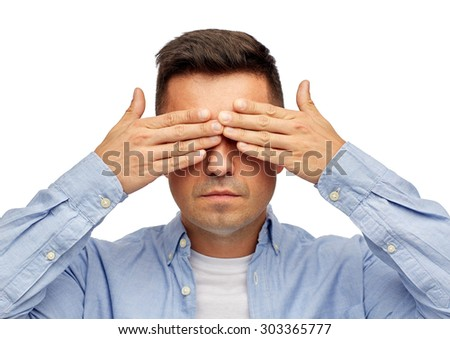 problem, sight, vision, stress and people concept - face of middle aged latin man covering his eyes with hand palms - stock photo