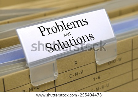problems and solutions printed on file folder - stock photo
