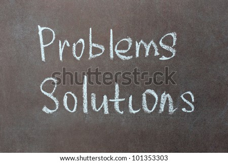 Problems and solutions written with chalk on school blackboard - stock photo