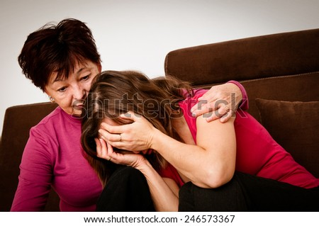 Problems - senior mother comforts daughter - stock photo