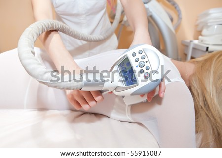 Procedure of vacuum massage in a beauty salon - stock photo