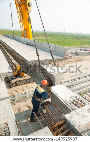 process of bridge construction to pass through it motorways - stock photo