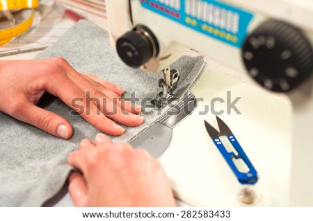 processes of sewing on the sewing machine sew women's hands sewing machine - stock photo