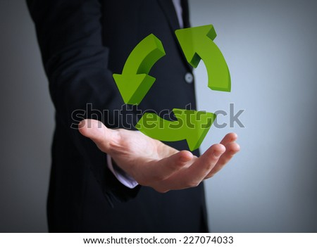 processing concept: arrows circle over businessman hand - stock photo