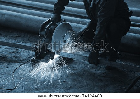 Processing of metal at a modern factory - stock photo