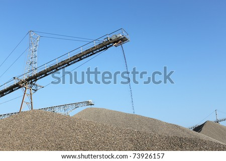 processing plant stones in sunny weather - stock photo