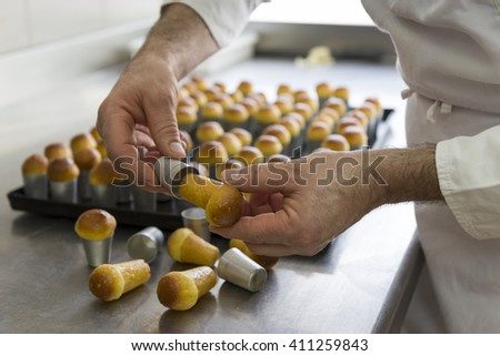 processing step for pastries just out from the oven - stock photo