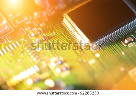 Processor chip on circuit board. Macro close-up, shallow DOF. - stock photo
