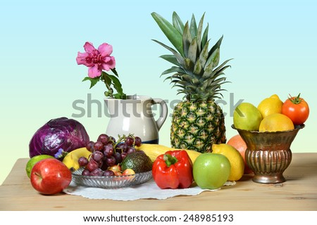 Produce on table isolated over a gradient background - stock photo