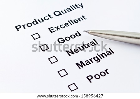 product quality evaluation with pen isolated over white background - stock photo