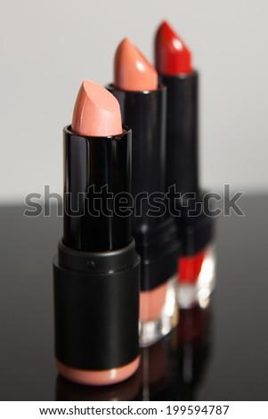 product shot of 3 lipsticks - stock photo