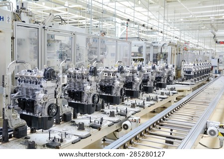 Production line for manufacturing of the engines in the car factory. Car factory. Car parts. Engine factory. New engine factory. Engines on line. - stock photo
