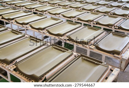 Production line in roof tile factory with raw tiles on the way to next level. - stock photo