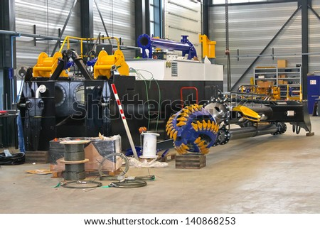 Production of the new dredger in the workshop shipyard - stock photo