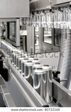 Production of tinplate cans - stock photo