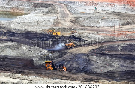 Production useful minerals. the dump truck at mining coal - stock photo