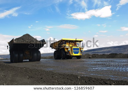 Production useful minerals. The two dump trucks. - stock photo