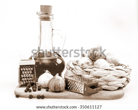 Products and kitchen utensils for cooking of garlic seasoning - stock photo