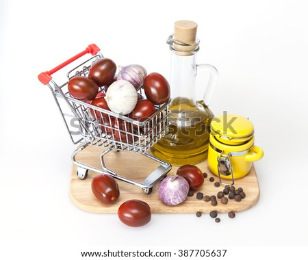 Products and kitchen utensils for cooking of seasoning from garlic and tomatoes - stock photo